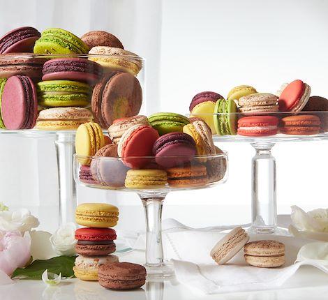 selection of macarons on glass plate Arnaud Larher